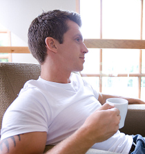 Thoughtful man with coffee cup